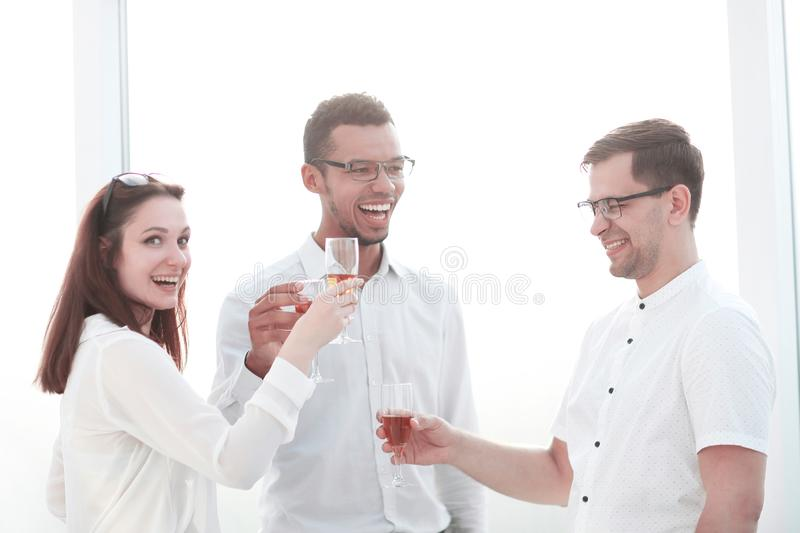 Close up.business team clinking glasses of wine. The concept of a successful startup stock image