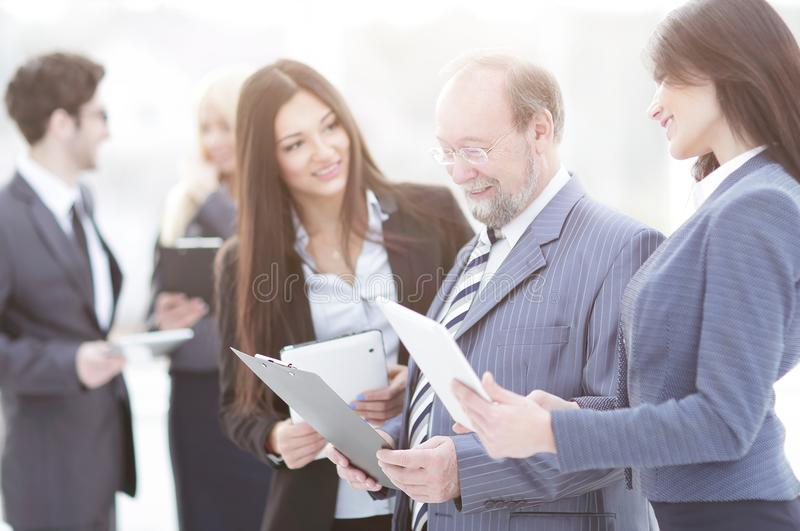 Close up.business team with clipboard talking to the Manager royalty free stock photography