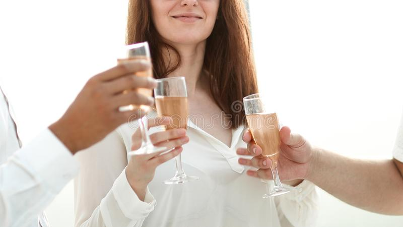 Close up.business team holding a glass of wine. Concept of success stock photography