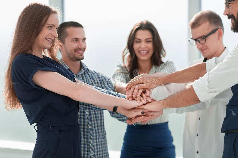 Close up. business team showing their unity. stock image