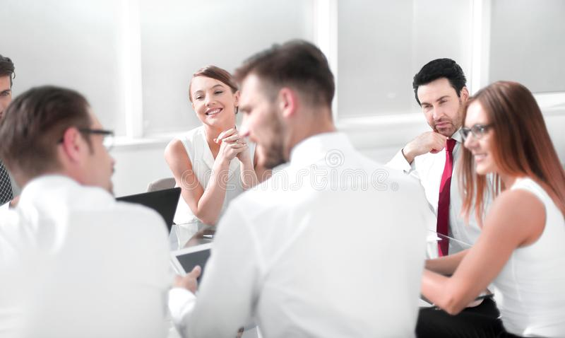 Close up.business team sitting at the office table stock photo