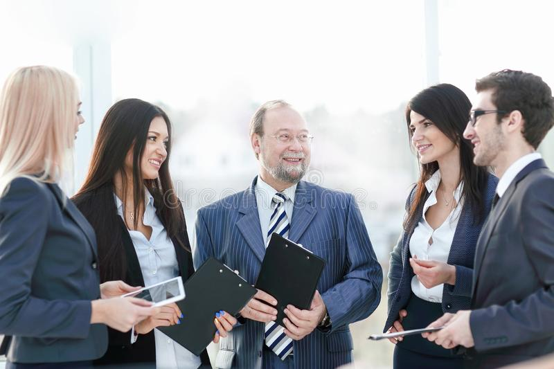 Close up.a business team standing talking in the office stock photos