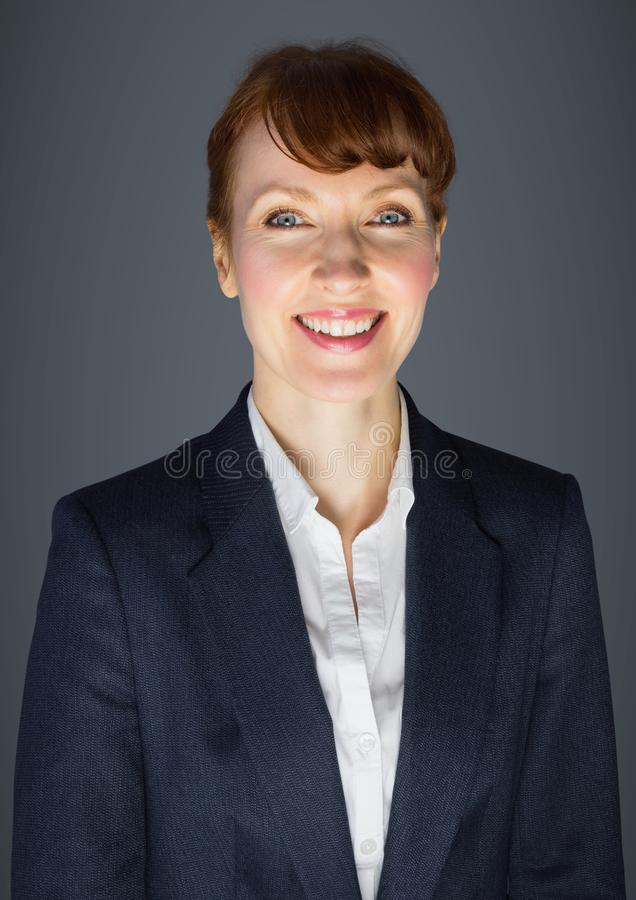 Close up of business woman against grey background stock photography