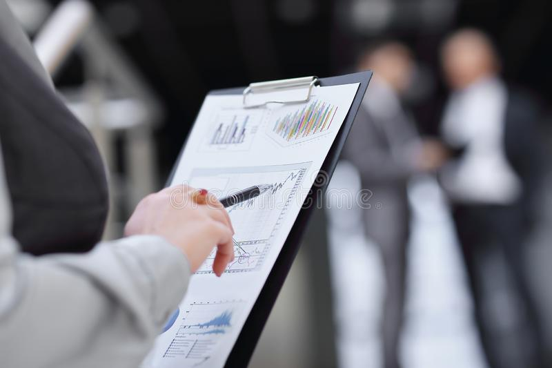 Close up. business woman checking financial report stock photos