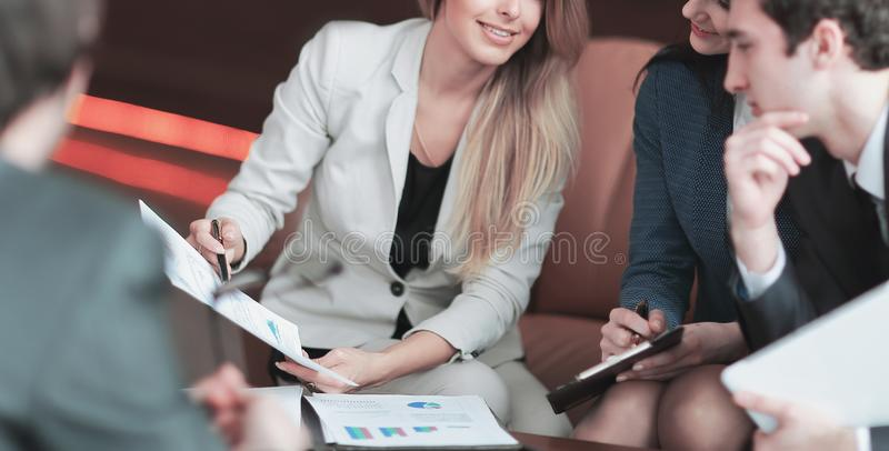 Close up.business woman discusses with business team marketing strategy stock photo