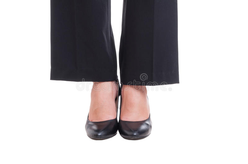 Close-up of business woman feet wearing black shoes standing tog. Ether isolated on white background stock images