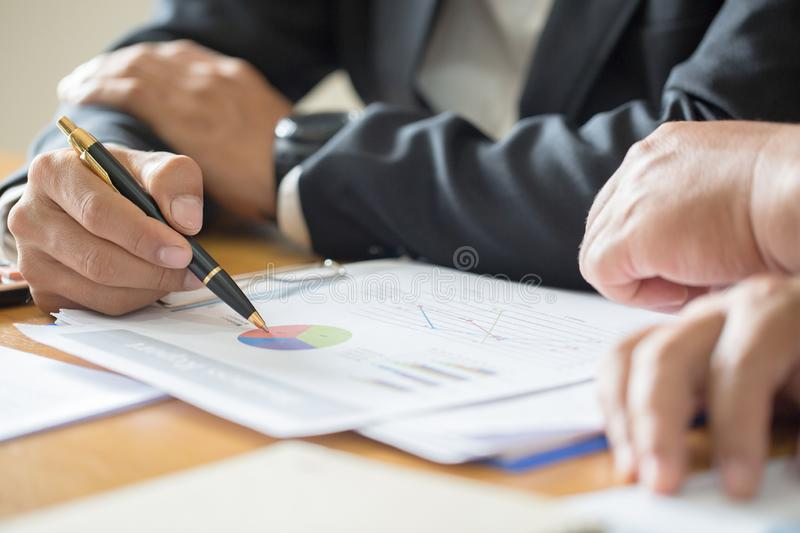 Close up of business woman hand working with financial business graph information, analyzing investment charts royalty free stock photo