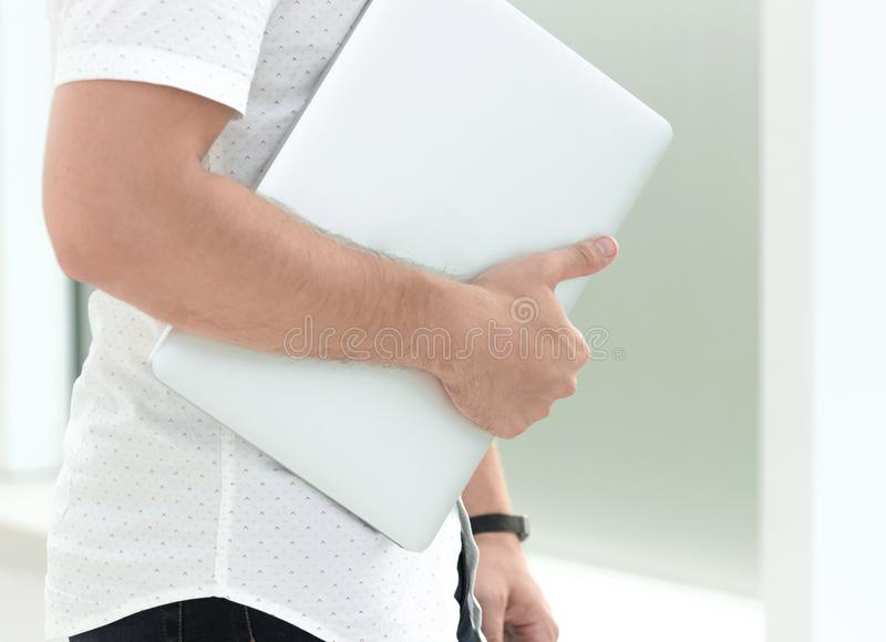 Close up. business woman with laptop standing near office window royalty free stock photography