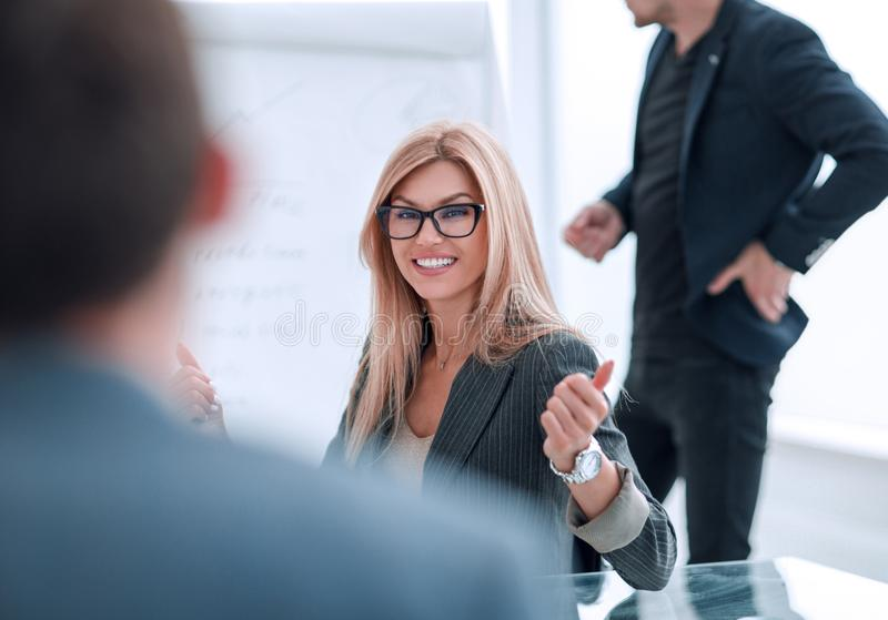 Close up. business woman at a business meeting with her business partner. royalty free stock images