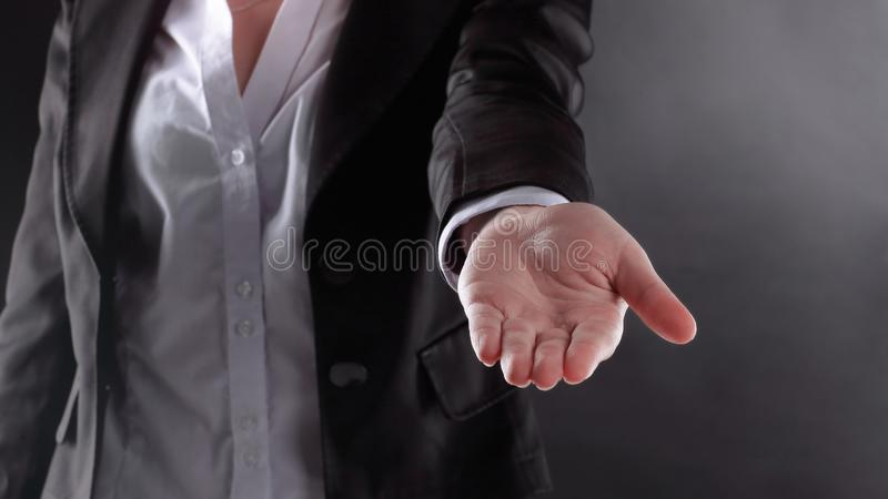 Close up. business woman with open palm . on black background.  stock photos