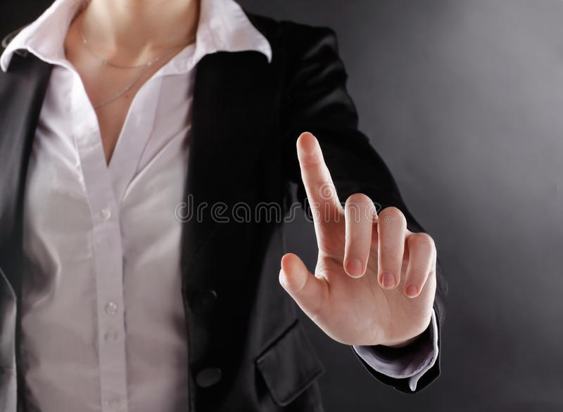 Close up. business woman presses a virtual button.isolated on black background.  stock image