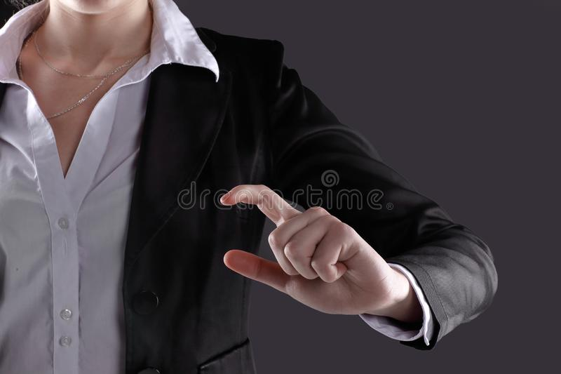 Close up.business woman showing a gesture a small part.isolated on black background.  stock photo