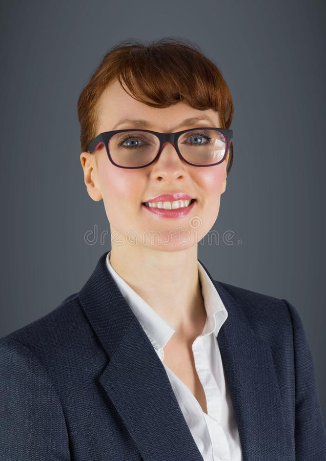 Close up of business woman smiling against grey background stock photos