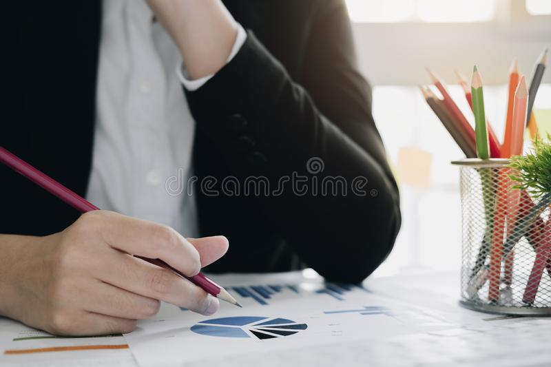 Close up Business woman using calculator for do math finance on wooden desk in office and business working background, tax, stock image