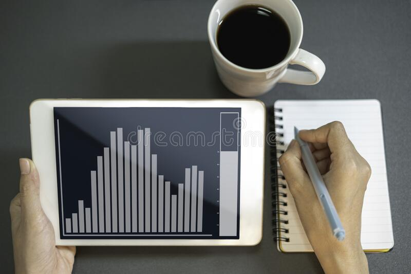Close up business women working analyze business graph in tablet stock images