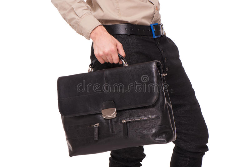 Close-up of businessman with briefcase. Close-up of young businessman holding black briefcase, isolated on white background royalty free stock photos