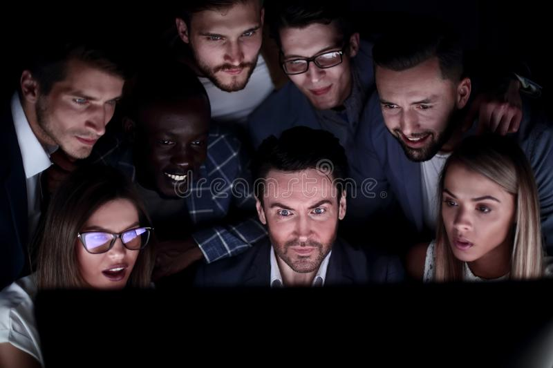 Close-up of businessman and business team looking at computer monitor stock photo