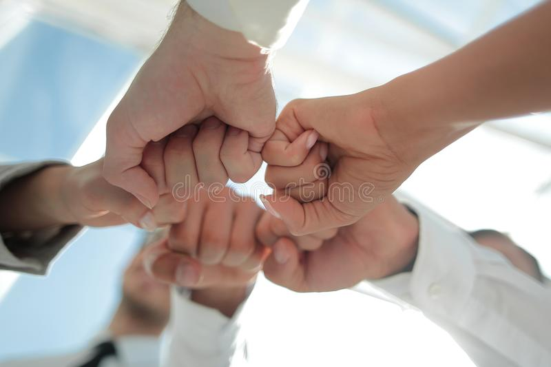 Close up .businessman and businesswoman making a fist bump on building background stock photo