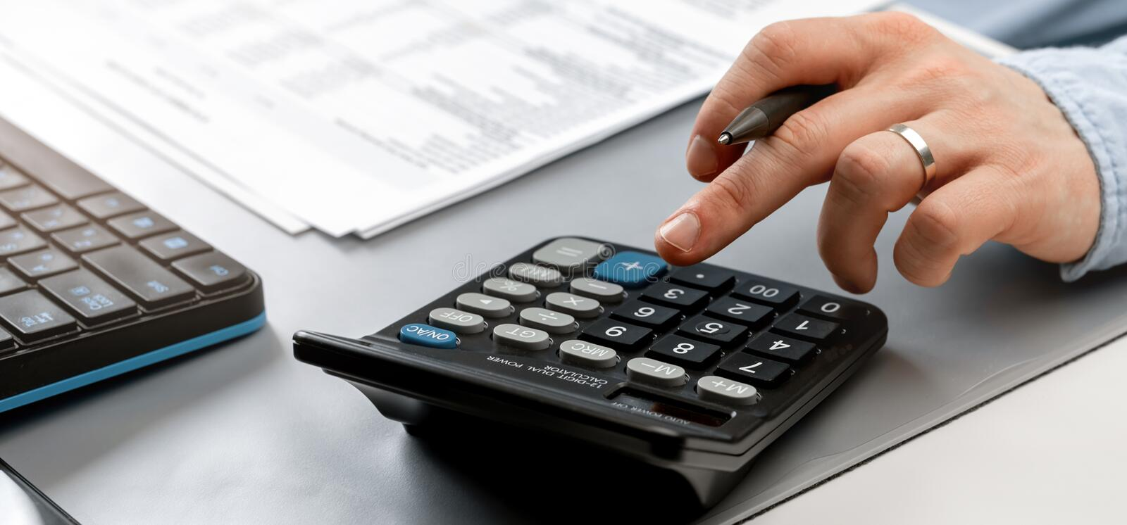 Close up businessman calculate on paper document financial data. Finance concept stock photo