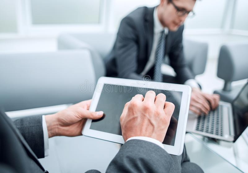 Close up.businessman with a digital tablet in a modern office stock image