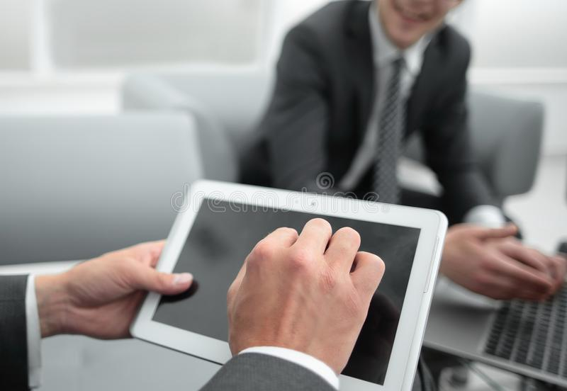 Close up.businessman with a digital tablet in a modern office stock photography