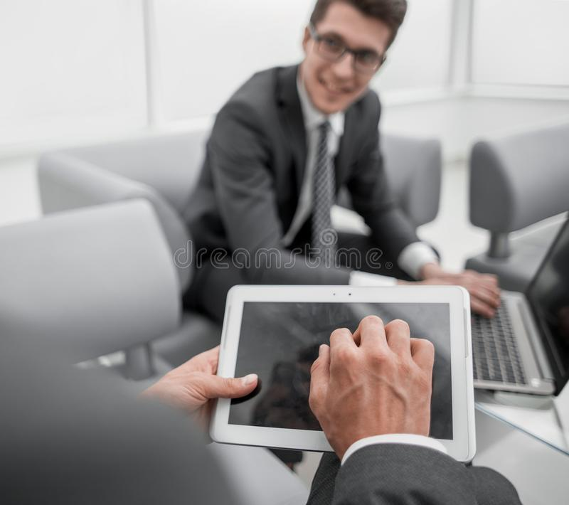 Close up.businessman with a digital tablet in a modern office stock photos