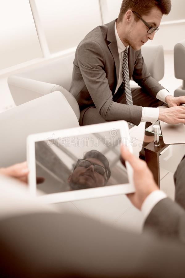 Close up.businessman with a digital tablet in a modern office royalty free stock image