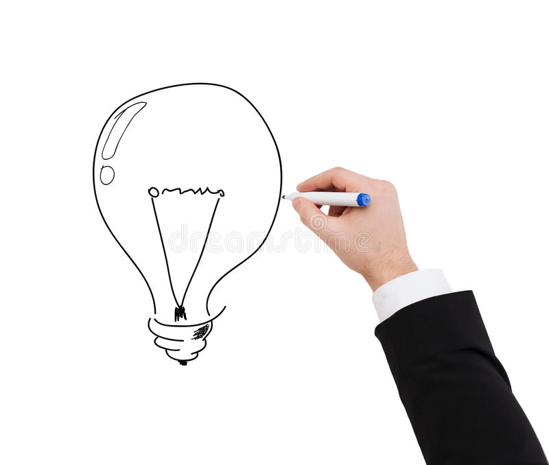 Close up of businessman drawing light bulb. Business and advertisement concept - close up of businessman drawing light bulb royalty free stock photo