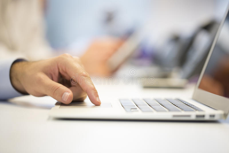 Close-up of businessman hands typing on laptop, Office Backgrou stock photo