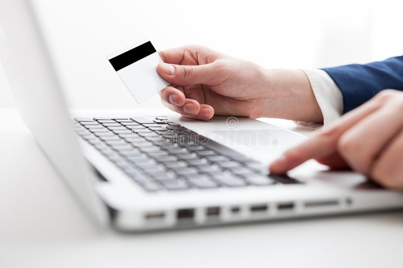 Close Up of businessman hands using laptop computer with blank c royalty free stock images