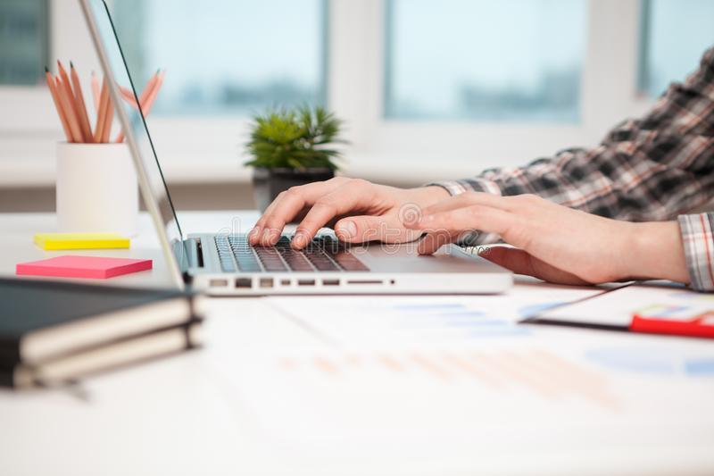 Close Up of businessman hands using laptop computer royalty free stock photo