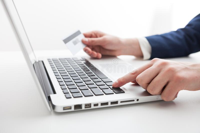 Close Up of businessman hands using laptop computer royalty free stock image