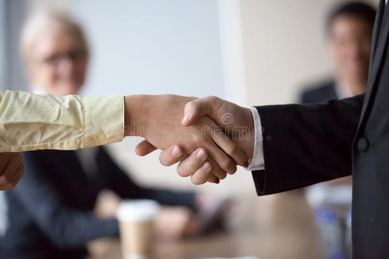 Close up of businessman handshake intern greeting with promotion. Close up of businessman shaking hand of colleague at office meeting, congratulating with work royalty free stock photo