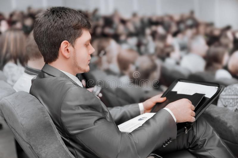 Close up.businessman listening to the speaker in the conference room stock photos