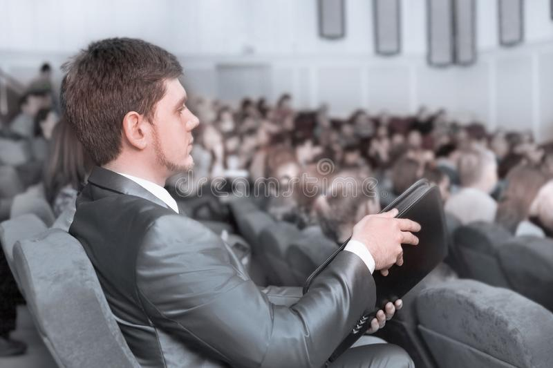 Close up.businessman listening to the speaker in the conference room stock image