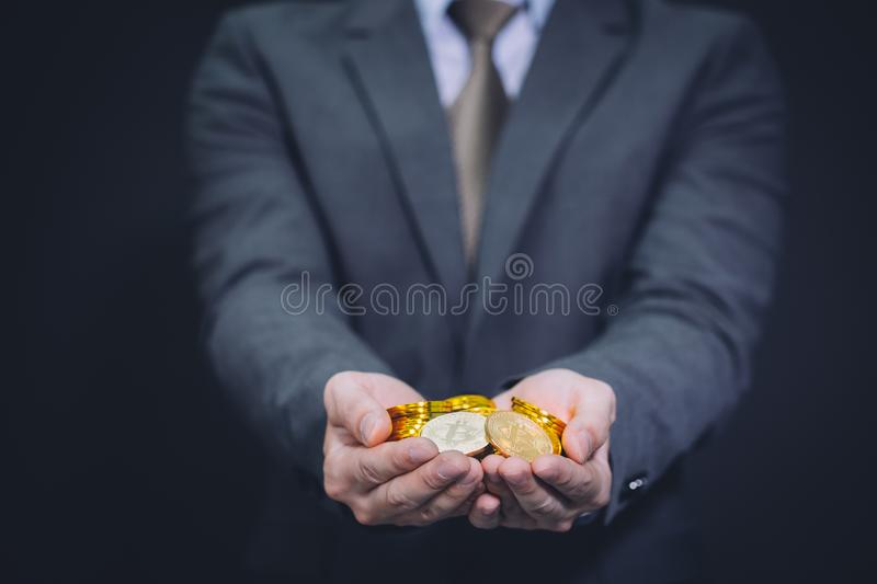 Close-up of businessman`s hands full of bitcoin sign of coins. Close-up of businessman`s hands full of bitcoin sign of coins - cryptocurrency financial trade royalty free stock images