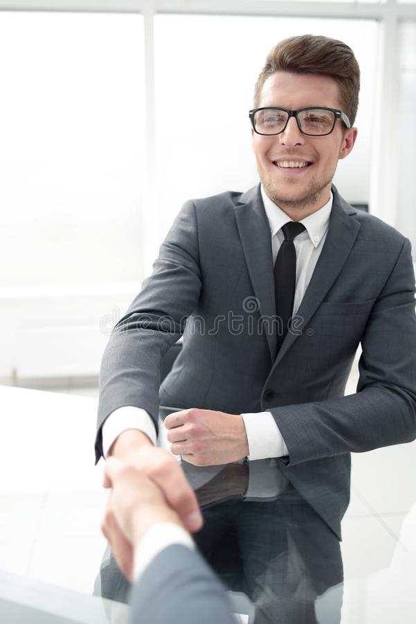 Close up.businessman shaking hands with his business partner stock images