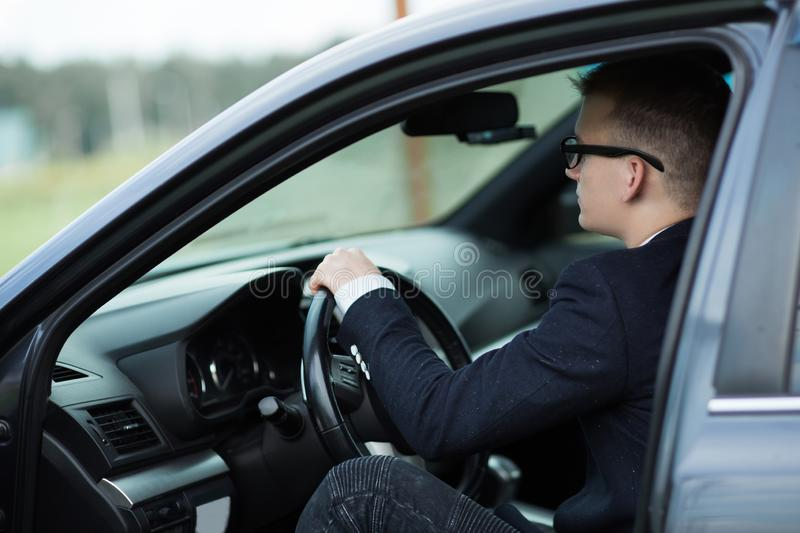 Close up.businessman sitting behind the wheel of a prestigious car royalty free stock photos