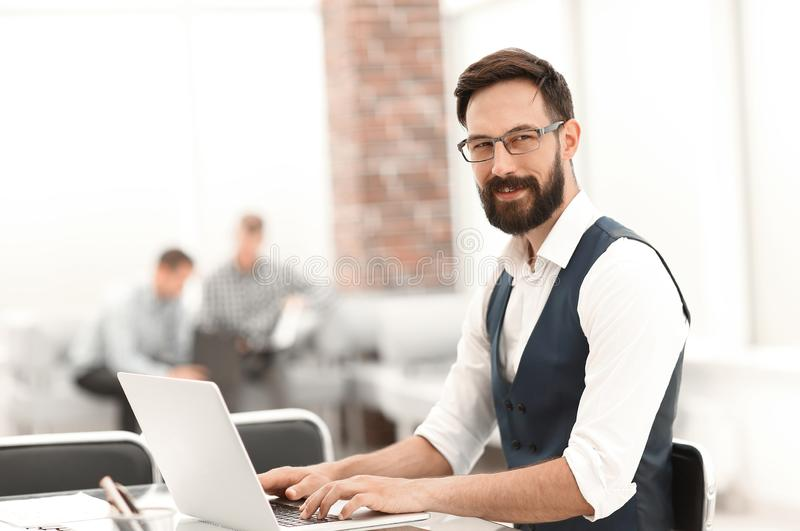 Close up. businessman sitting at the office Desk royalty free stock photo