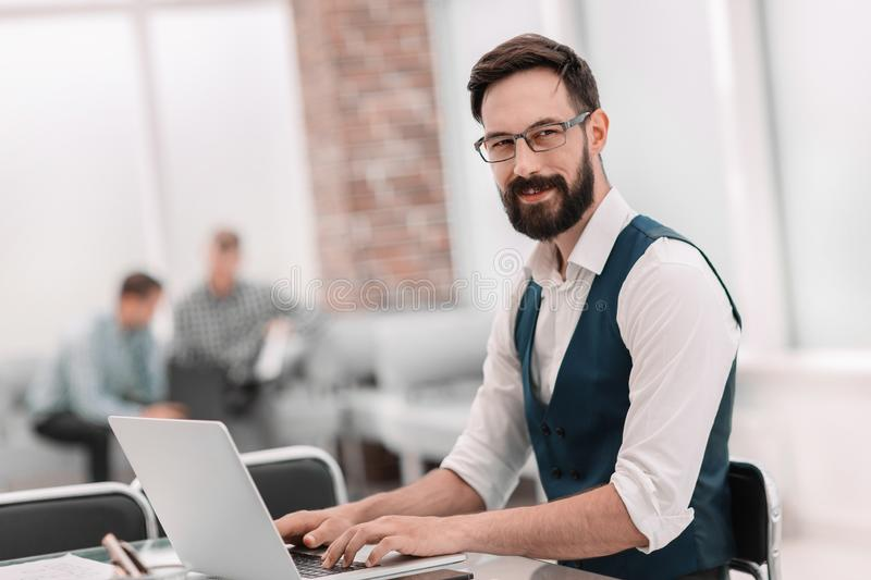 Close up. businessman sitting at the office Desk royalty free stock image