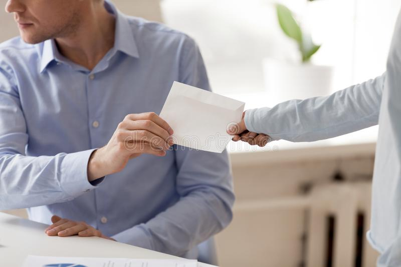 Close up businessman taking envelope with bribe from woman. Client giving, offering money to dishonest man, making secret illegal deal, partners planning fraud stock photos