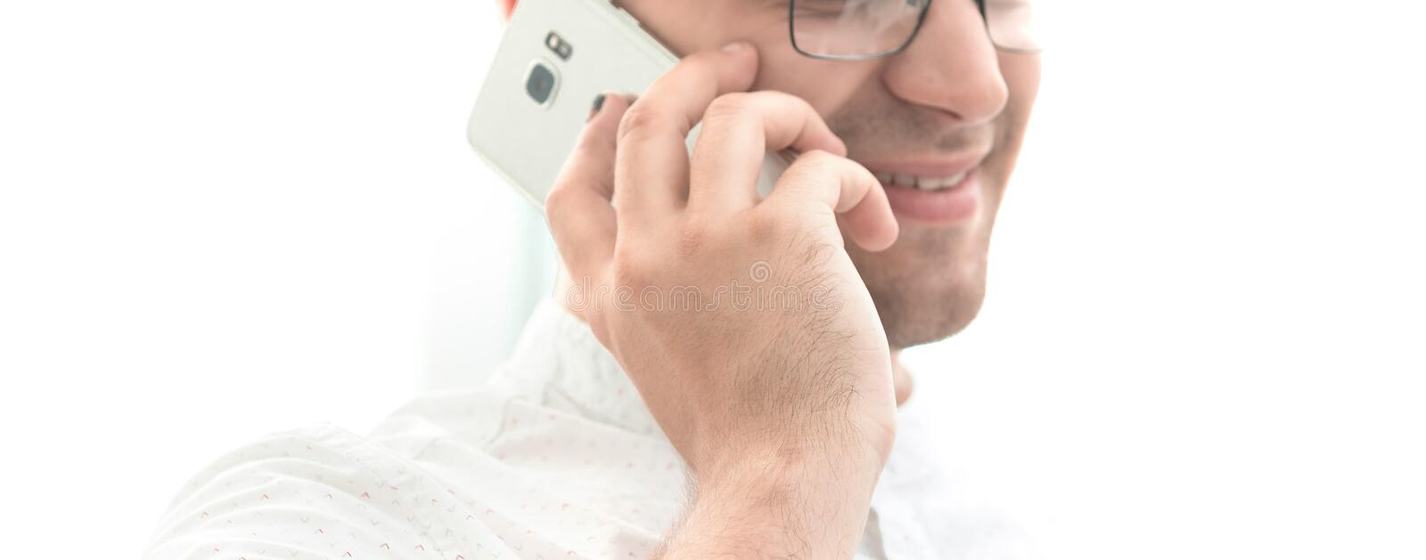 Close up. businessman talking on mobile phone. royalty free stock image