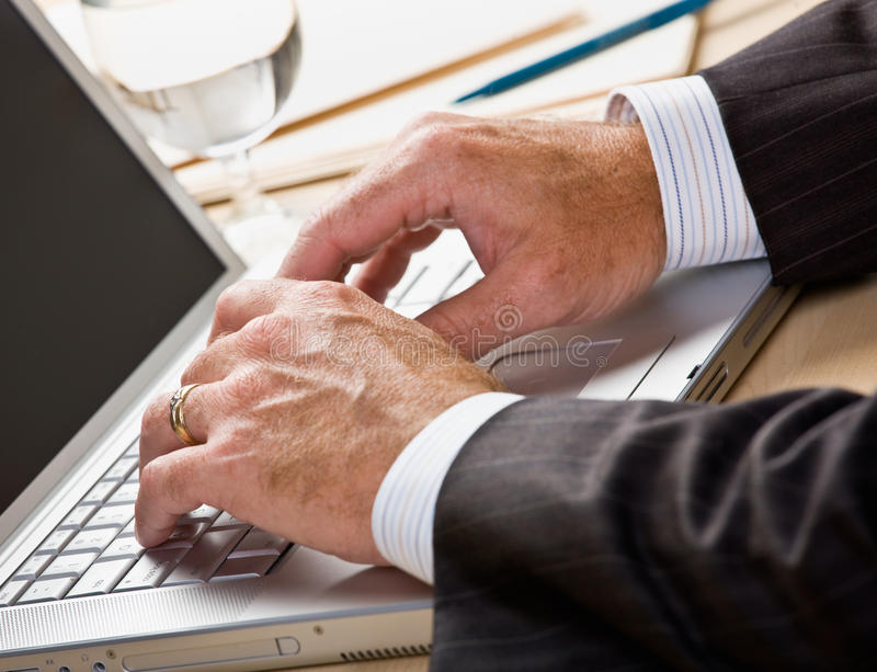 Close up of businessman typing on laptop royalty free stock photos