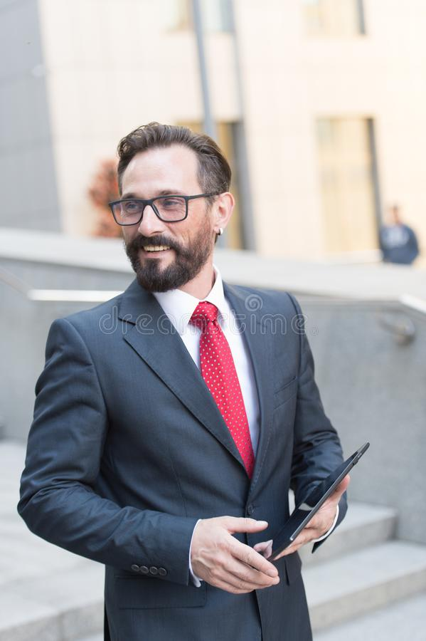 Close-up of businessman using digital tablet at work. Portrait of handsome bearded businessman outdoor. stock image