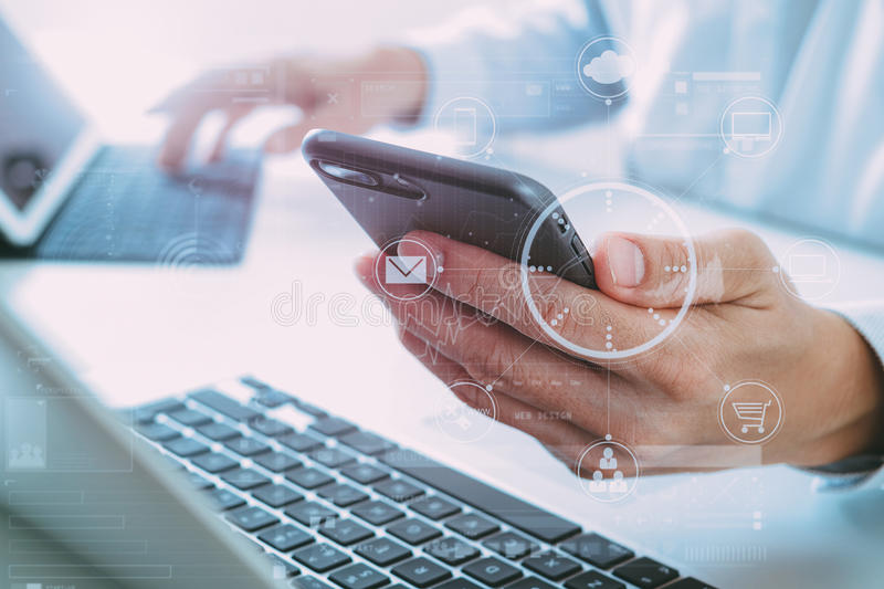 close up of businessman using mobile phone and laptop computer o stock illustration