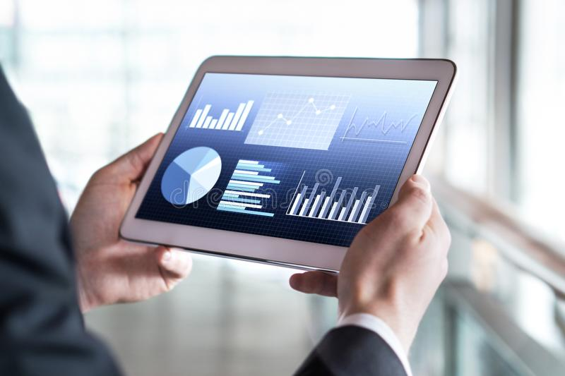 Close up of businessman using tablet in modern office building. stock images