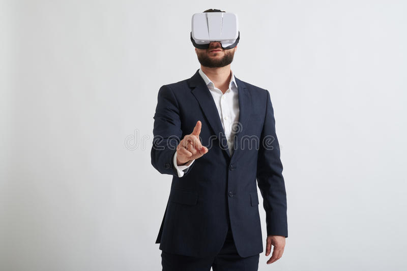 Close up of businessman in virtual reality glasses who trying to stock photography