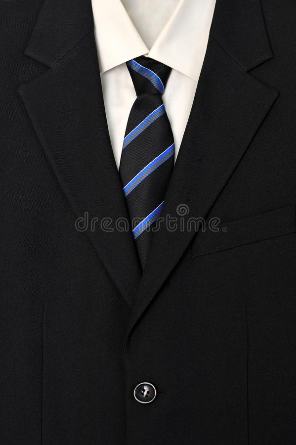 Close up of businessman wearing a tie, shirt, and suit. stock photography