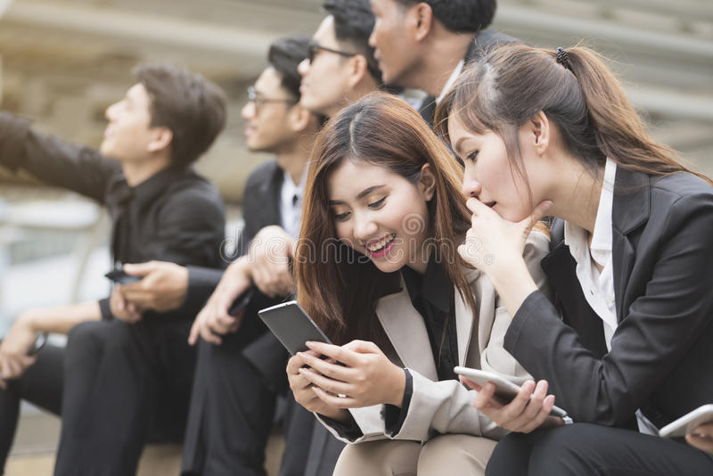 Close up of businessmen and businesswomen using smartphone royalty free stock photography