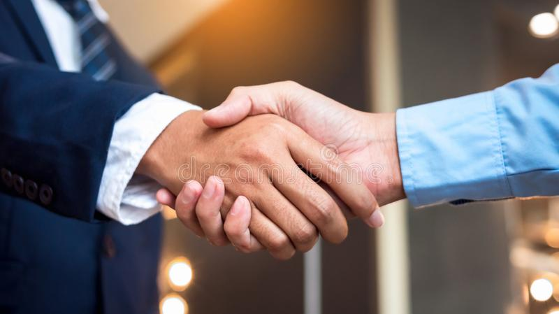 Close up businessmen shaking hands during a meeting. Handshake deal business corporate stock photo